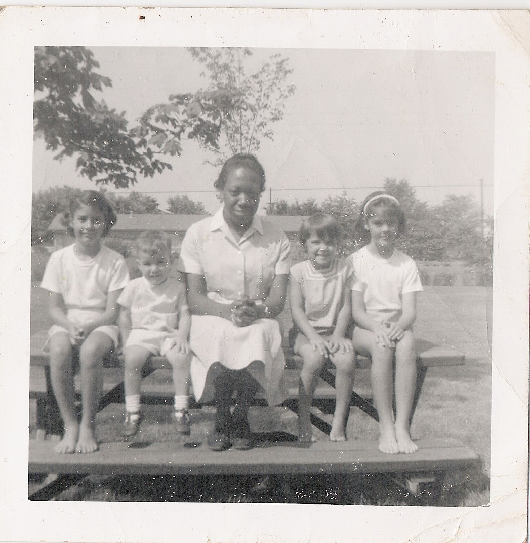 photo: my great-aunt in her day work uniform with the children she kept
