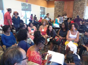 Writers of color gather at a publishing workshop.