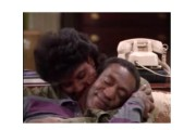 Screenshot of a Cosby Show episode featuring Cliff and Claire snuggling on the sofa